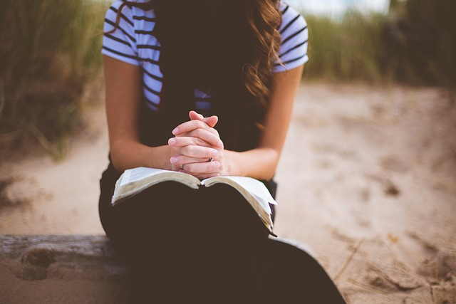 Woman with Bible praying