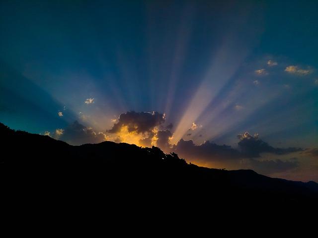 Sunrise peeking over a mountain