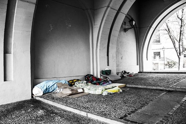 Homeless bedding under a bridge